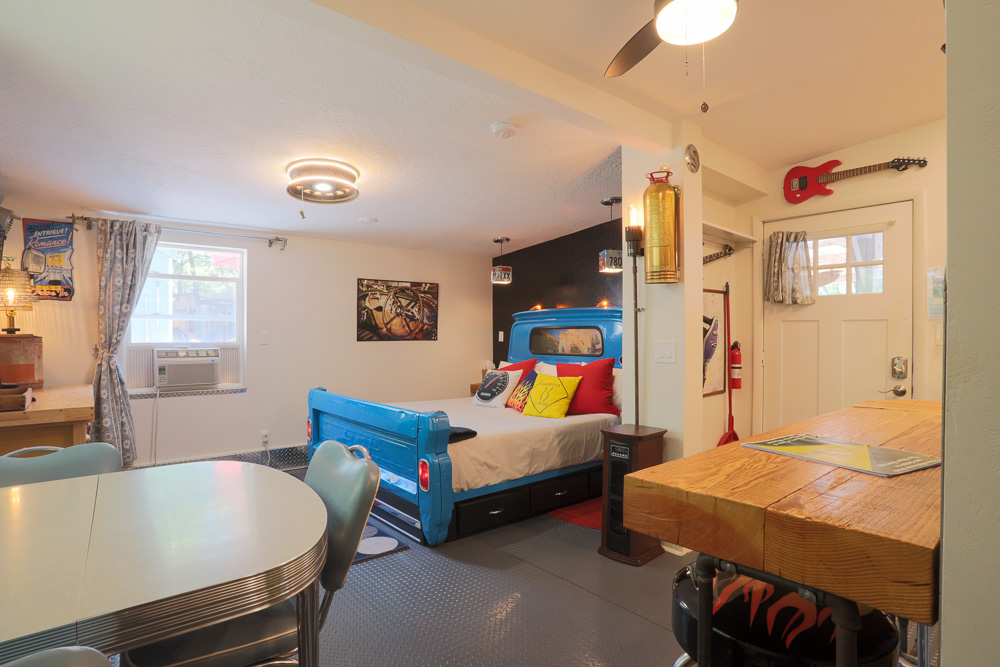 Vacation rental garage themed property with pick up bed and bright decor in Kanab Utah