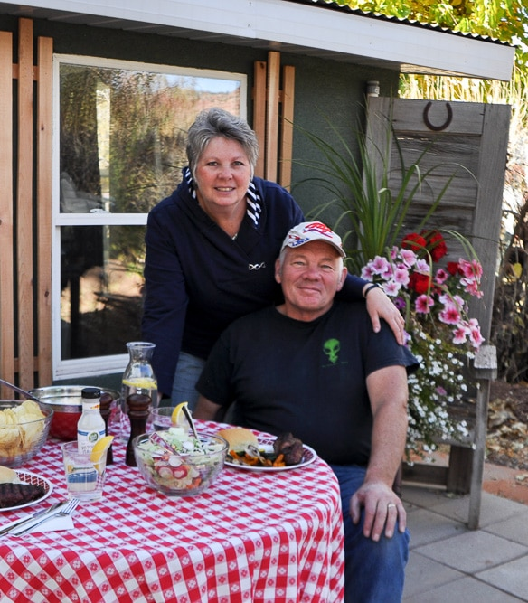 Vacation rental property owners husband and wife posing at their rental in Kanab Utah